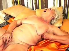 Granny with highly hirsute slit named Norma rubs it with a new toy in the afternoon