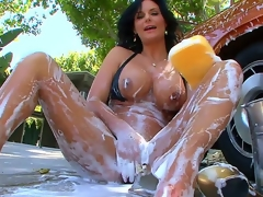 The kinky milf with large mounds and large round wazoo Phoenix Marie is outdoor washing the car and likewise foaming her own sexy body that is stretched and ready for masturbation