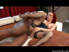 Experienced curvy redhead milf Shannon Kelly with large fake balloons and bouncing arse in fishnet stockings gets her shaved minge pounded hard by tall dark hunk to loud agonorgasmos