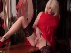 Nylons and sexy red costume on golden-haired milf