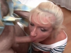 Mature bitch in fishnets and skirt sucks jocks