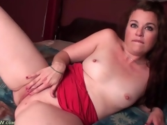 Cute solo mamma with small scoops masturbates in bed