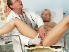 Aged Romana gynochair pussy speculum investigation by gyno doctor