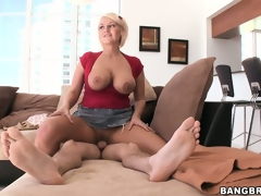 Bootylicious golden-haired MILF with giant jugs mounts a unbending wiener