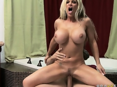 Stacked blonde uses her fake billibongs to rub and squeeze a large dick