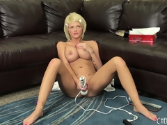 Busty golden-haired Joslyn toys her pussy and vibrates her love button on the couch, then acquires on the floor