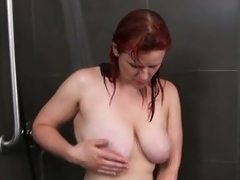 Breasty dilettante milf masturbates in the shower